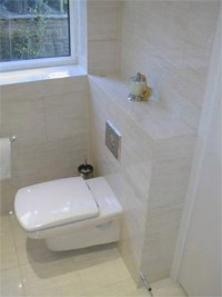 White bathroom furniture and cream tiling - Dublin bathroom installation by Dublin Bathrooms, Ireland