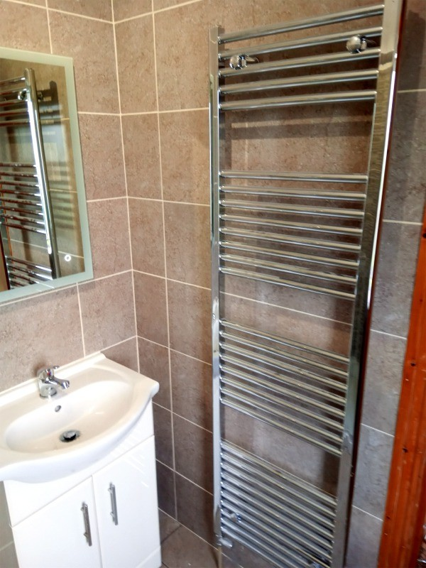 Radiator and vanity unit in a Dublin shower room as installed by Dublin Bathrooms