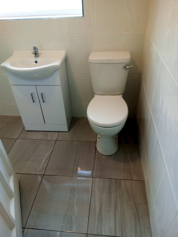 Toilet and vanity unit in a Dublin shower room as installed by Dublin Bathrooms
